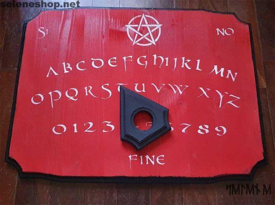 tavola ouija rossa puntatore nero