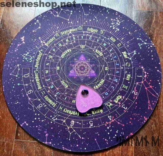 purple round ouija board